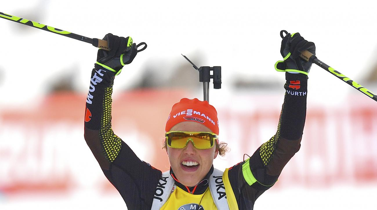 Germany's winner Laura Dahlmeier celebrates in the finish area after the women's 10 km pursuit competition at the Biathlon World Championships in Hochfilzen, Austrian province of Tyrol , Austria, Sunday, Feb. 12, 2017. (AP Photo/Kerstin Joensson)
