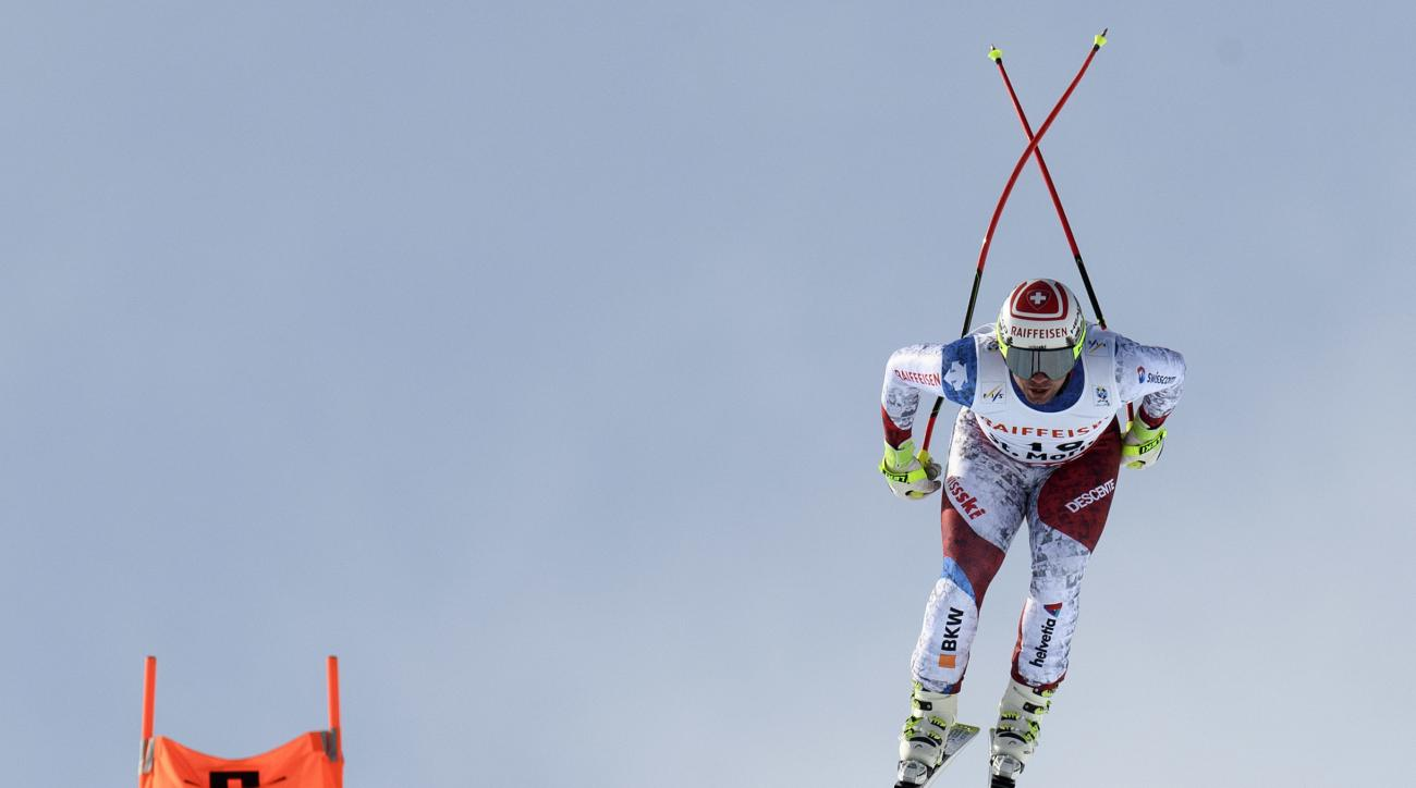 Beat Feuz of Switzerland is airborne during the men downhill race at the 2017 Alpine Skiing World Championships in St. Moritz, Switzerland, Sunday, Feb.  12, 2017. (Jean-Christophe Bott/Keystone via AP)