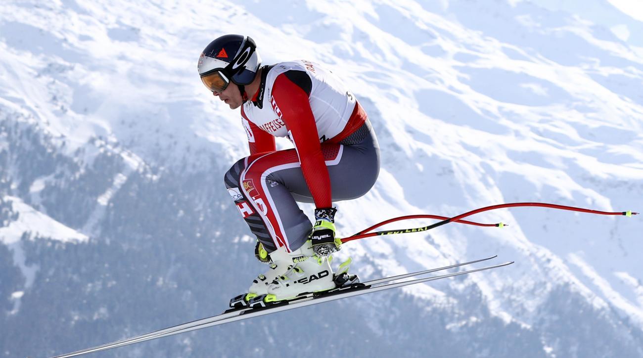 Canada's Erik Guay competes during a men's downhill race, at the alpine ski World Championships in St. Moritz, Switzerland, Sunday, Feb.12, 2017. (AP Photo/Alessandro Trovati)