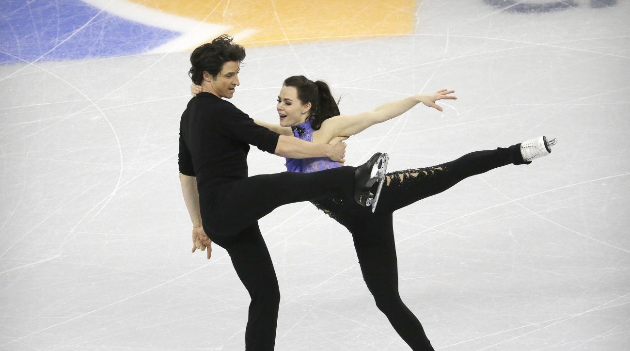 Tessa Virtue and Scott Moir from Canada perform in the Ice Dance Short Dance program at the ISU Four Continents Figure Skating Championships in Gangneung, South Korea, Thursday, Feb. 16, 2017. (AP Photo/Ahn Young-joon)