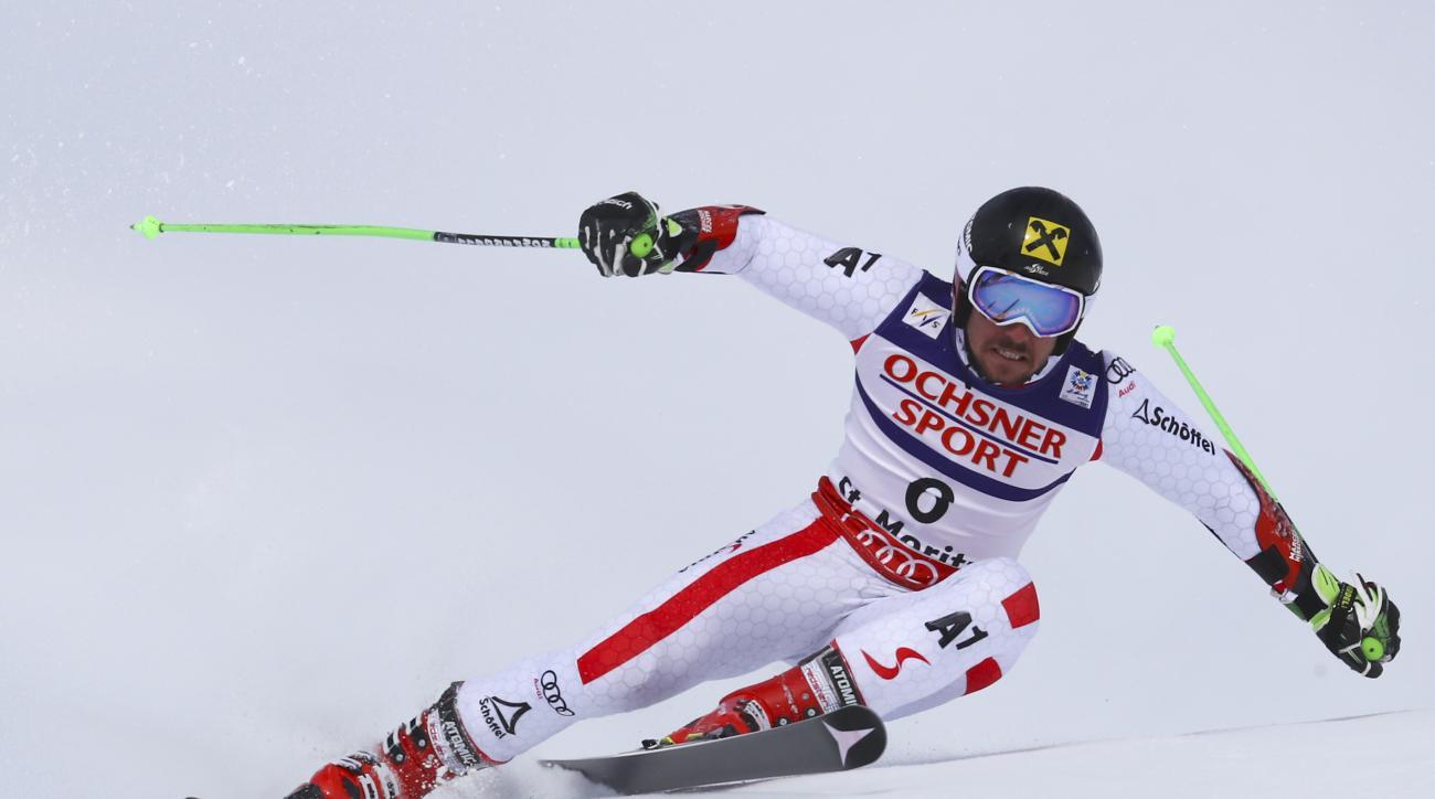 Austria's Marcel Hirscher competes during a men's giant slalom, at the alpine ski World Championships, in St. Moritz, Switzerland, Friday, Feb. 17, 2017. (AP Photo/Alessandro Trovati)