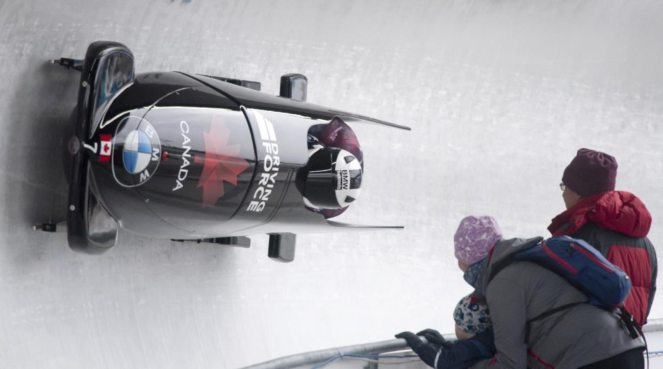Canada's Justin Kripps  and  Jesse Lumsden speed down the track during the first run of the two-man bobsleigh competition at the Bobsleigh World Championships at Lake Koenigssee, Germany, Saturday, Feb. 18, 2017.  (Peter Kneffel/dpa via AP)