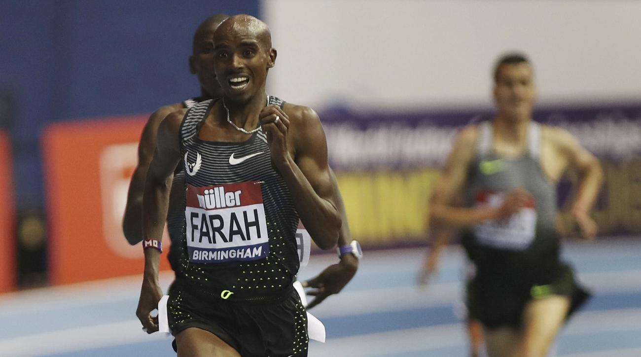 Britain's Mo Farah wins the 5000m during the Indoor Grand Prix at the Barclaycard Arena, Birmingham, England, Saturday Feb. 18, 2017. (David Davies/PA via AP)