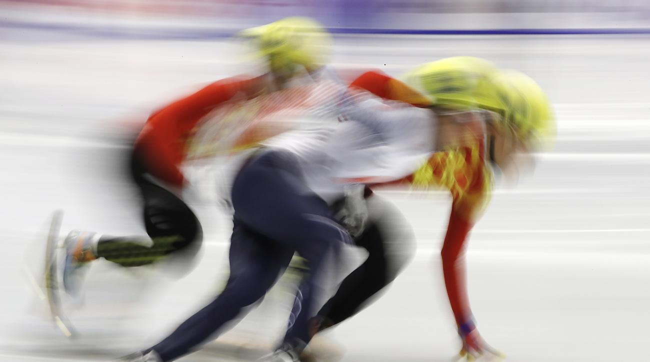 Han Tianyu, left, of China, Park Se-yeong, center, of South Korea, and Ren Ziwei, right, of China compete during the men's 500 meters semifinals of short track speed skating competition at the Asian Winter Games at Makomanai Indoor Skating Rink in Sapporo