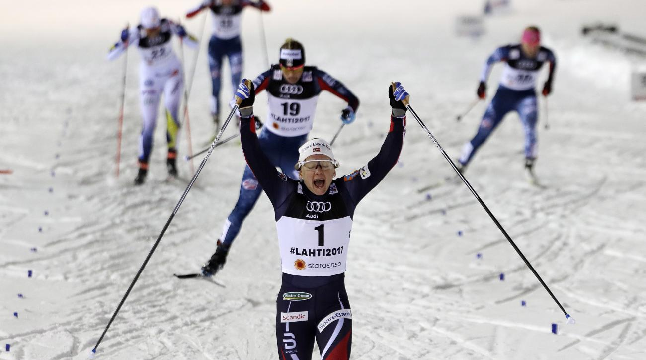 Norway's Maiken CaspersenFalla crosses the finish line to win in the women's cross country sprint final at the 2017 Nordic Skiing World Championships in Lahti, Finland, Thursday, Feb. 23, 2017. (AP Photo/Matthias Schrader)