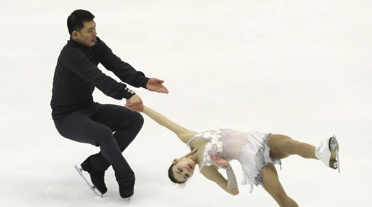 Yu Xiaoyu and Zhang Hao of China perform in the Pairs Free Skating program of Figure Skating competition at Makomanai Indoor Skating Rink at the Asian Winter Games in Sapporo, northern Japan, Saturday, Feb. 25, 2017. (AP Photo/Eugene Hoshiko)