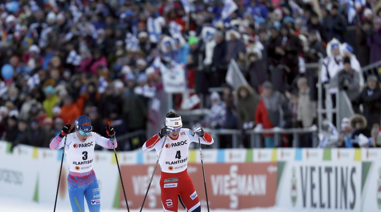 Finland's KristaParmakoski, left, and Norway's MaritBjoergen, right, compete during the women's skiathlon 7.5 km classic and 7.5 km free competition at the 2017 Nordic Skiing World Championships in Lahti, Finland, Saturday, Feb. 25, 2017. (AP Photo/Matthi