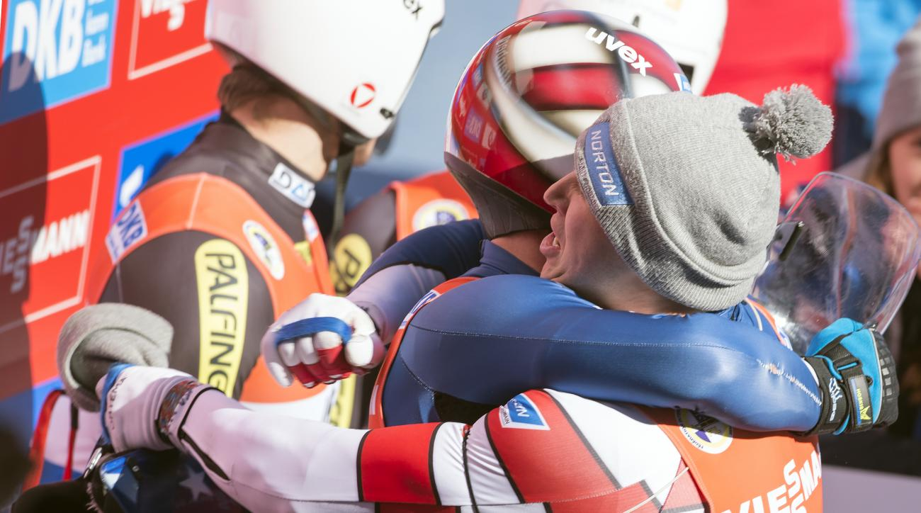 Matt Mortensen, right, and Jayson Terdiman, left, of the US celebrate their second place during the doubles luge World Cup race in Altenberg, eastern Germany, Saturday, Feb. 25, 2017. (AP Photo/Jens Meyer)