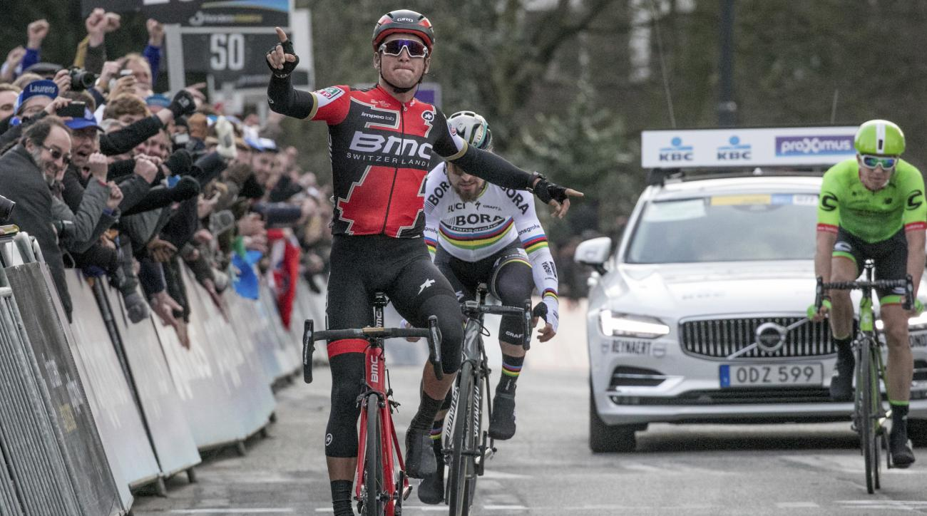 Belgian Greg Van Avermaet from BMC racing Team, front, celebrates as he wins the Belgian cycling classic Omloop Het Nieuwsblad in Ghent, Belgium, on Saturday, Feb. 25, 2017. Slovak Peter Sagan from Bora-Hansgrohe and Belgian Sep Vanmarcke from Cannondale-