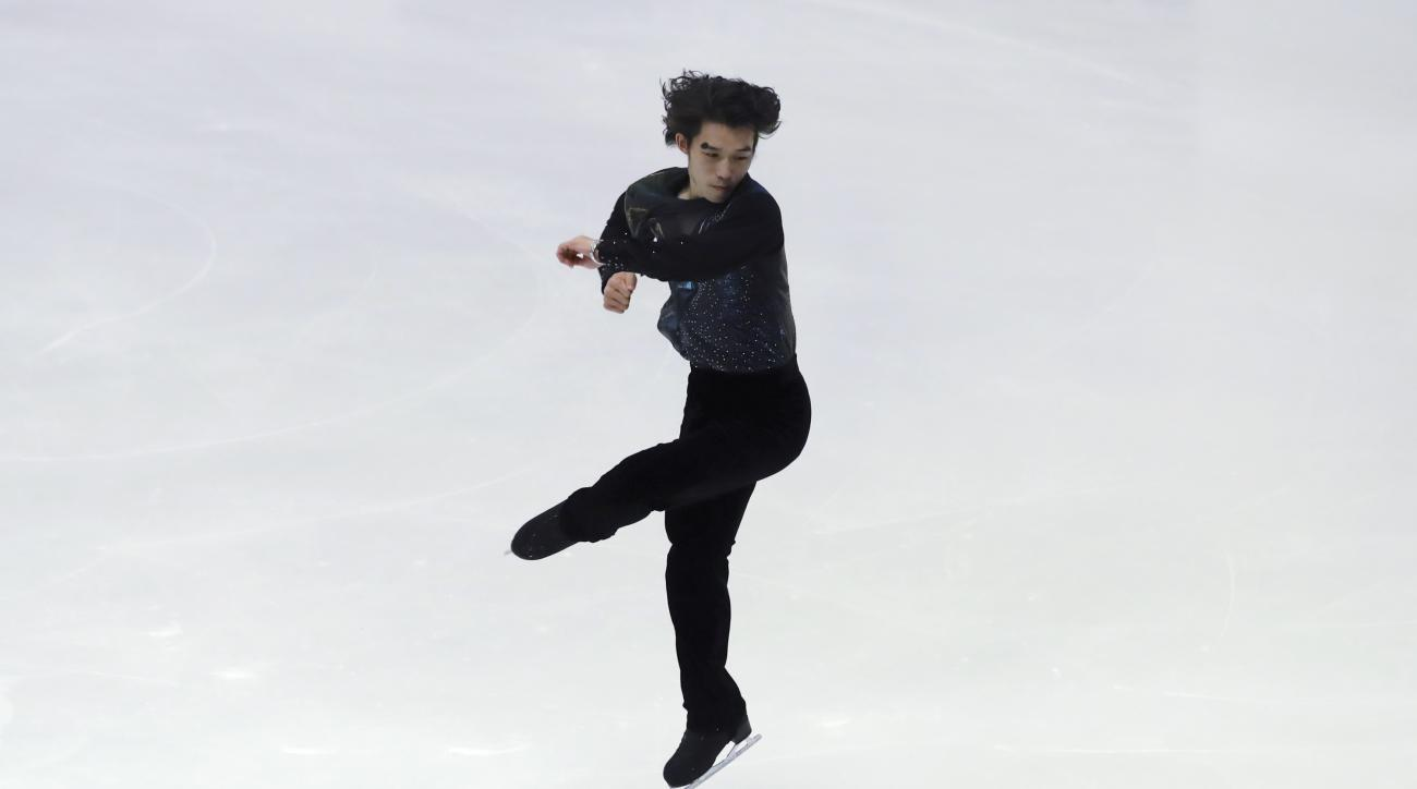 Takahito Mura of Japan performs in the Men's Free Skating program of Figure Skating competition at Makomanai Indoor Skating Rink at the Asian Winter Games in Sapporo, northern Japan, Sunday, Feb. 26, 2017. (AP Photo/Eugene Hoshiko)