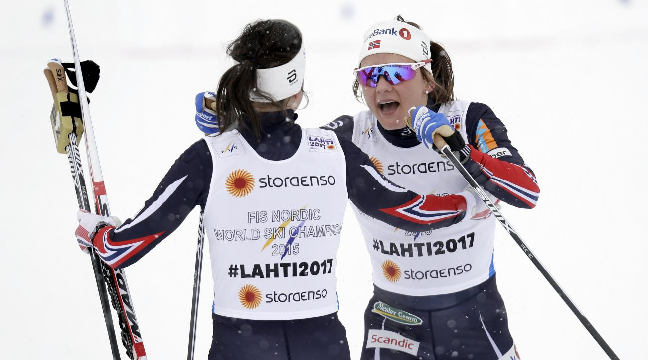First placed Norway's HeidiWeng, left, and Norway's Maiken CaspersenFalla, right, celebrate after the women's 6 x 1.3 km team sprint classic competition at the 2017 Nordic Skiing World Championships in Lahti, Finland, Sunday, Feb. 26, 2017. (AP Photo/Matt