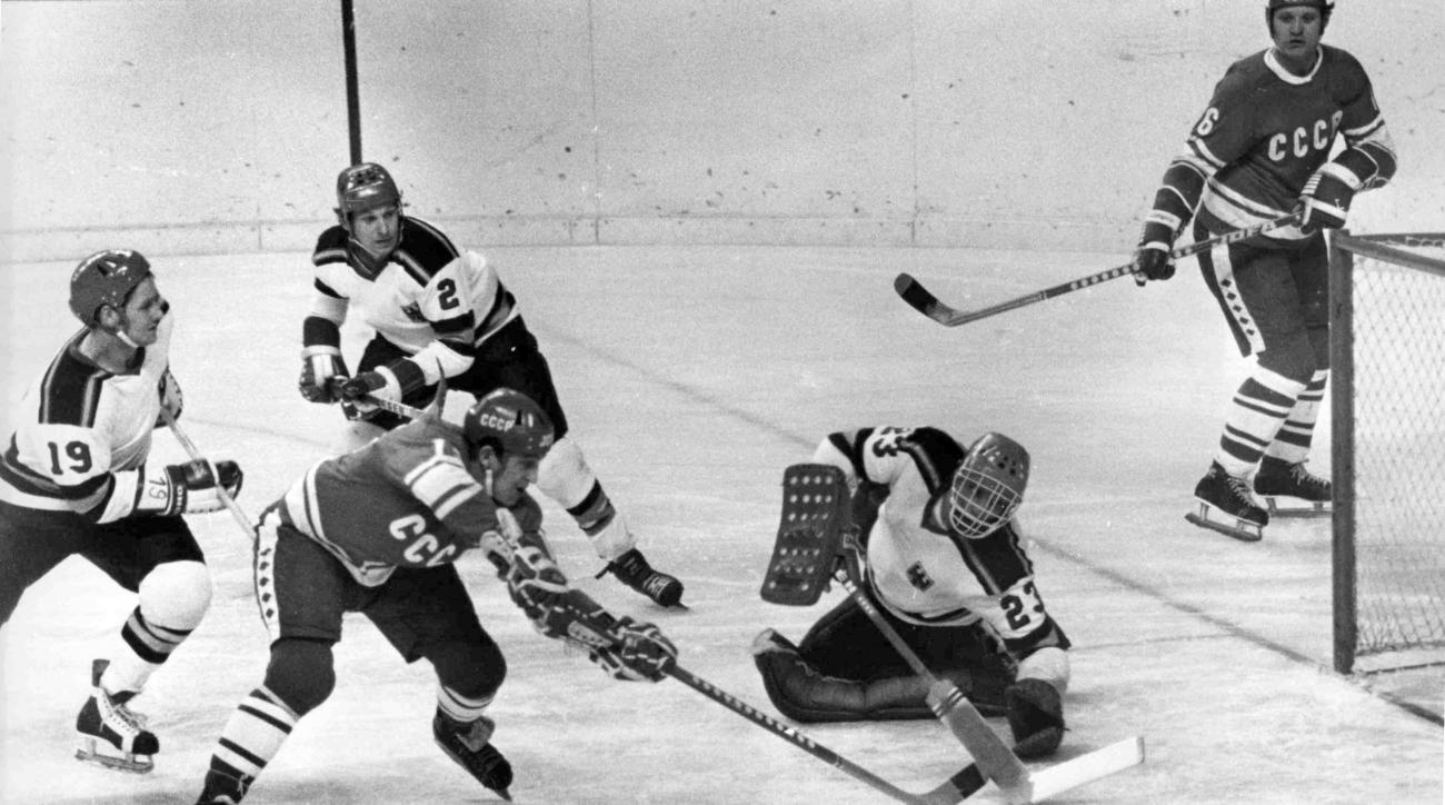 FILE - A Feb. 10, 1976 photo from files showing  the Soviet Union's Vladimir Petrov, second left, scoring a goal during the XII Winter Olympic Games Men's Ice Hockey group B match against West Germany, in Innsbruck, Austria. Petrov, a two-time Olympic hoc