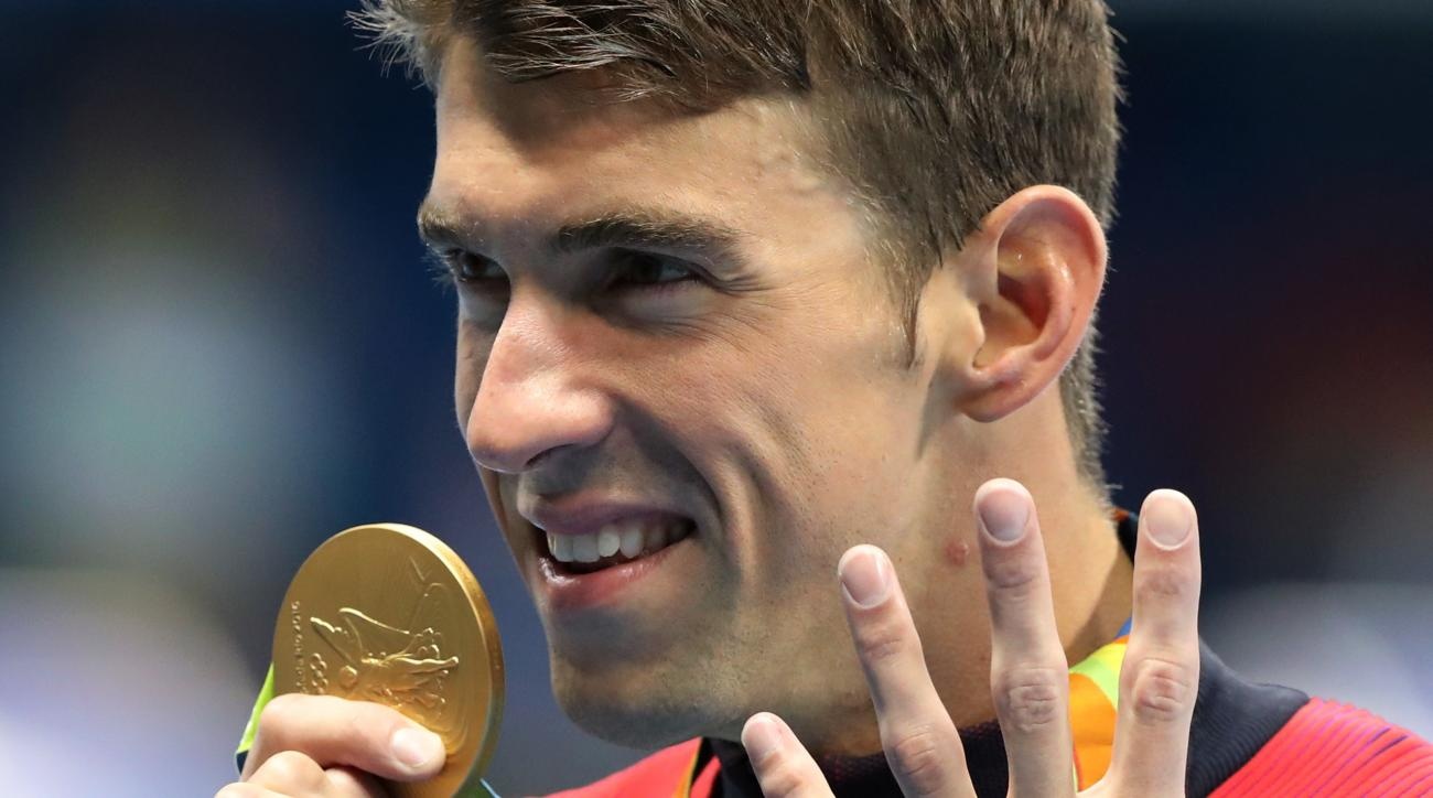 FILE - In this Aug. 11, 2016 file photo, United States' Michael Phelps celebrates winning the gold medal in the men's 200-meter individual medley during the swimming competitions at the 2016 Summer Olympics,  in Rio de Janeiro, Brazil. (AP Photo/Lee Jin-m