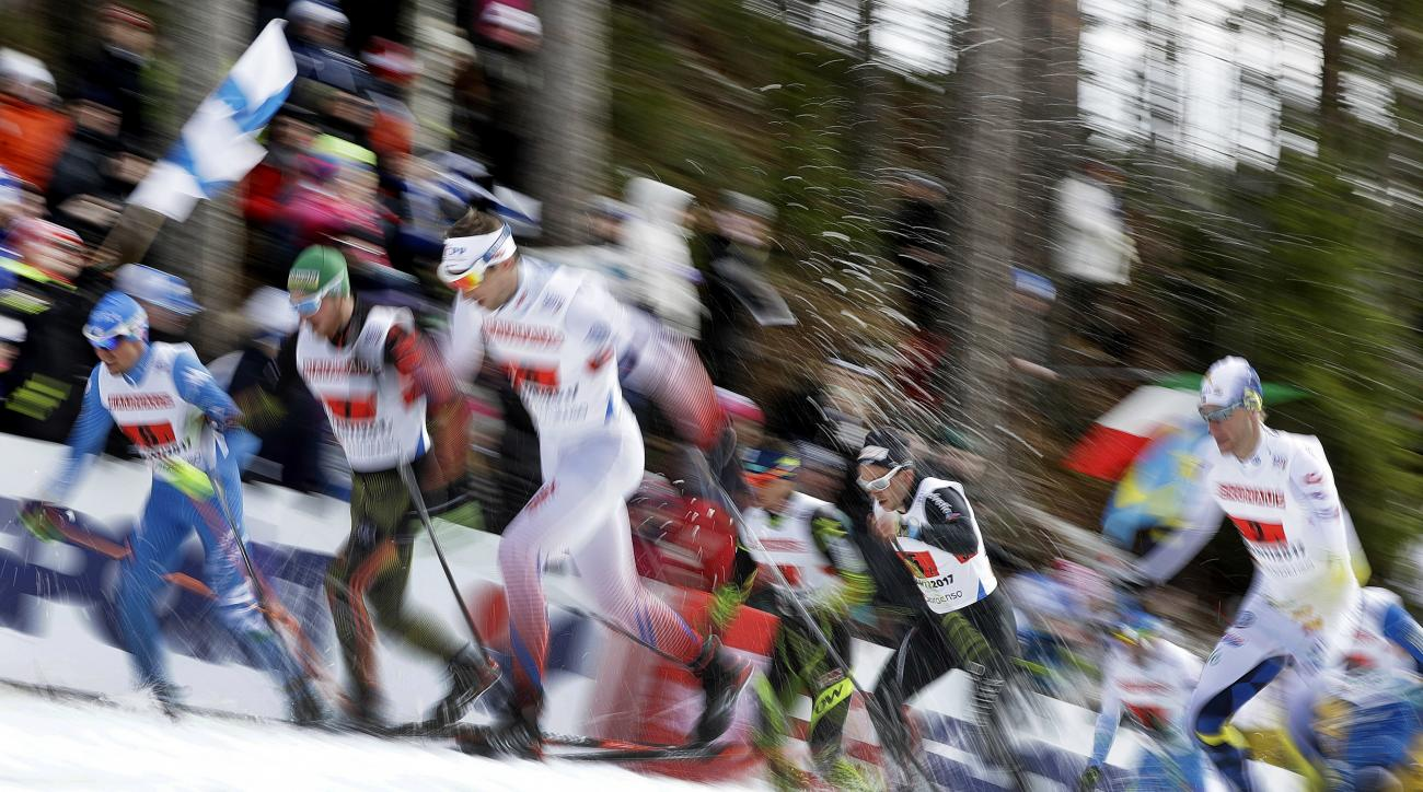 Athletes start for the men's 4x10 km Relay race at the 2017 Nordic Skiing World Championships in Lahti, Finland, Friday, March 3, 2017. (AP Photo/Matthias Schrader)