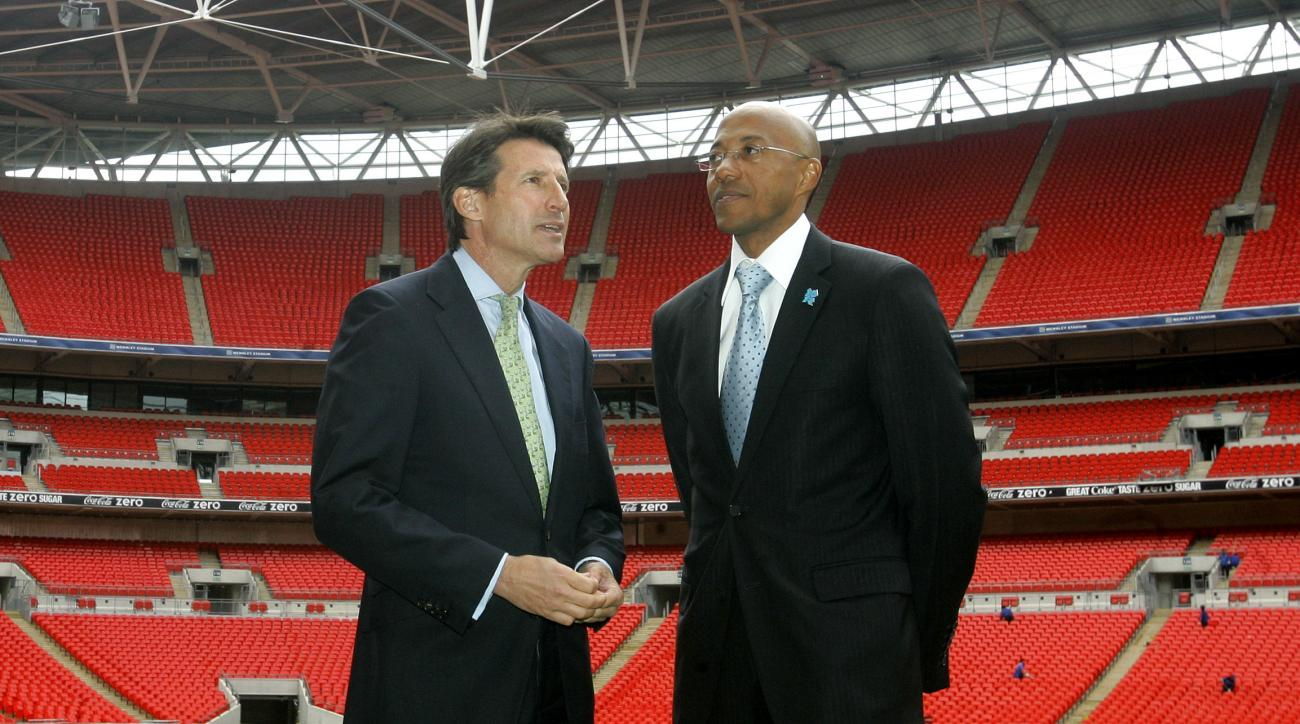 FILE - This is a Tuesday, May 20, 2008  file photo of Namibian former athlete Frank Fredericks, right, as he  takes a look on the Wembley Pitch with Sebastian Coe during a visit by the International Olympic Committee to Wembley Stadium in London. The Inte
