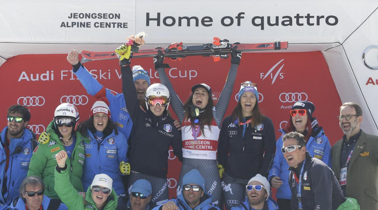 Italy's Sofia Goggia, top center, celebrates with her team members after winning the women's World Cup downhill at the Jeongseon Alpine Center in Jeongseon, South Korea, Saturday, March 4, 2017. (AP Photo/Ahn Young-joon)