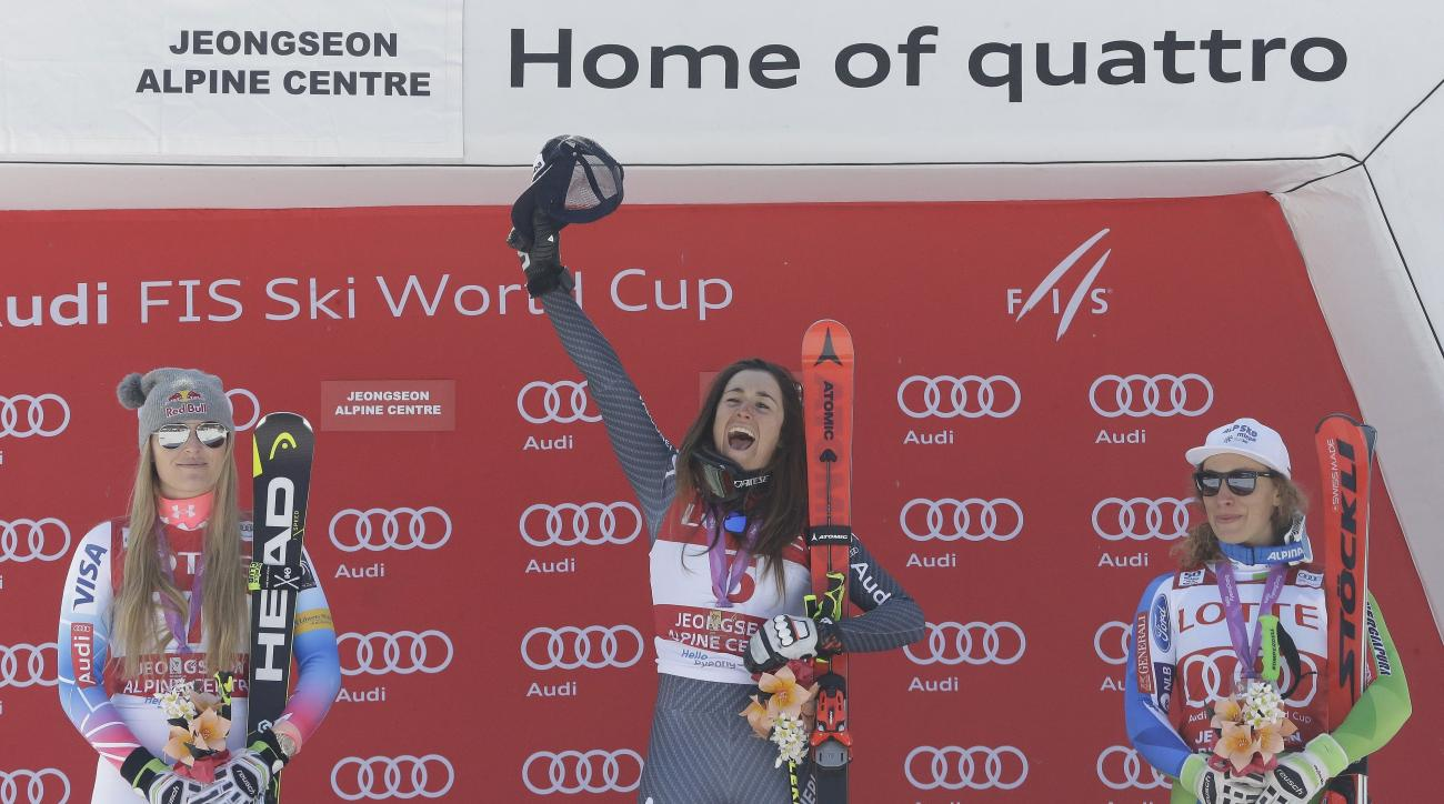 Italy's Sofia Goggia, center, celebrates with second placed United States' Lindsey Vonn, left, and the third placed Slovenia's Ilka Stuhec after winning the women's World Cup downhill at the Jeongseon Alpine Center in Jeongseon, South Korea, Saturday, Mar