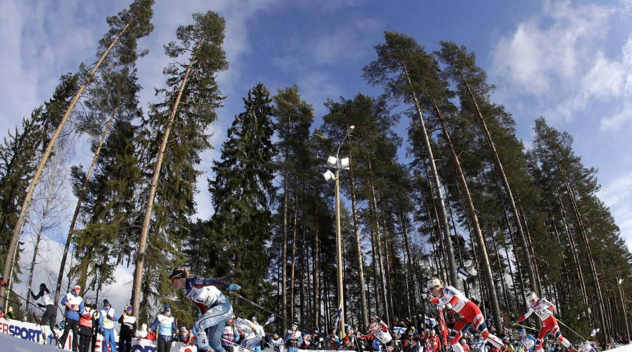 United States' JessicaDiggins, front left, competes during the women's cross country 30 km mass start free competition at the 2017 Nordic Skiing World Championships in Lahti, Finland, Saturday, March 4, 2017. (AP Photo/Matthias Schrader)