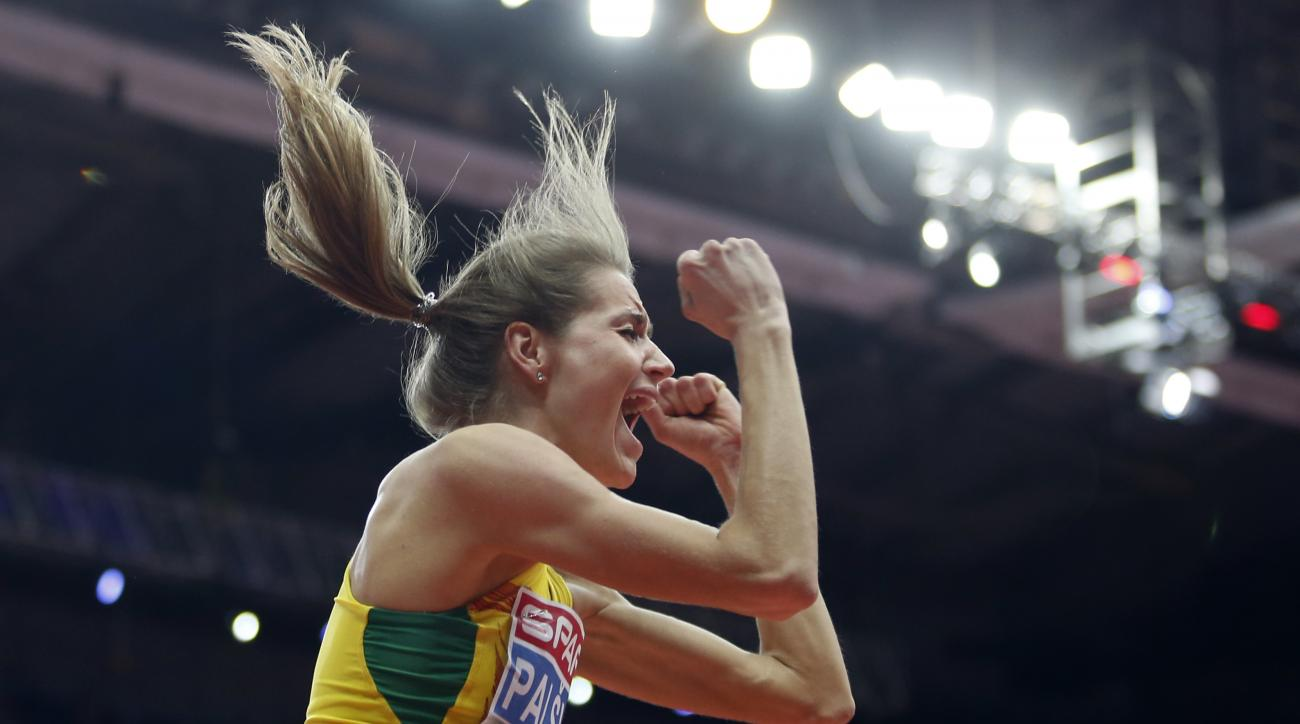 Lithuania's gold medal winner Airine Palsyte celebrates an attempt in the women's high jump final during the European Athletics Indoor Championships in Belgrade, Serbia, Saturday, March 4, 2017. (AP Photo/Marko Drobnjakovic)