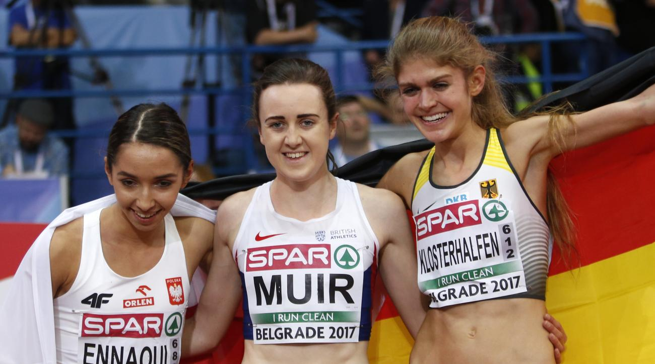 Britain's gold medal winner Laura Muir is flanked by Germany's silver medal winner Konstanze Klosterhalfen, right, and Poland's bronze medal winner Sofia Ennaoui after the women's 1500-meter final during the European Athletics Indoor Championships in Belg