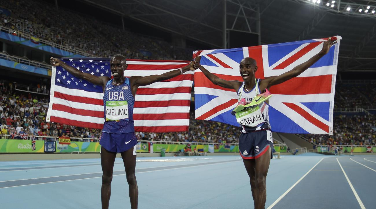 FILE - This is a Saturday, Aug. 20, 2016 file photo of Britain's gold medal winner Mo Farah, right, as he celebrates with United States' Paul Kipkemoi Chelimo, silver medalist, after  the 5,000 metres at the 2016 Summer Olympics in the Olympic stadium in