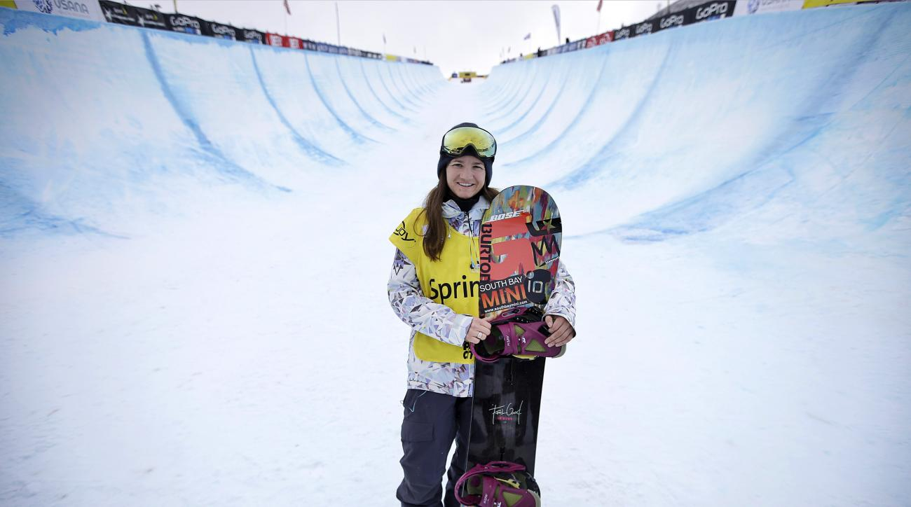 FILE - In this March 1, 2015, file photo, Kelly Clark, of the United States, poses for a photograph after competing in a World Cup halfpipe snowboard even, in Park City, Utah. Clark, with her gold medal and two bronze that she values every bit as much,  h