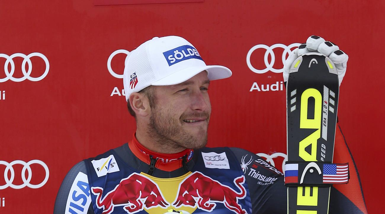 FILE - In this Jan. 25, 2014, file photo, third placed Bode Miller celebrates at the end of an alpine ski, men's World Cup downhill, in Kitzbuehel, Austria. Miller remains on the fence about a return to racing. If things should come together, the highly d