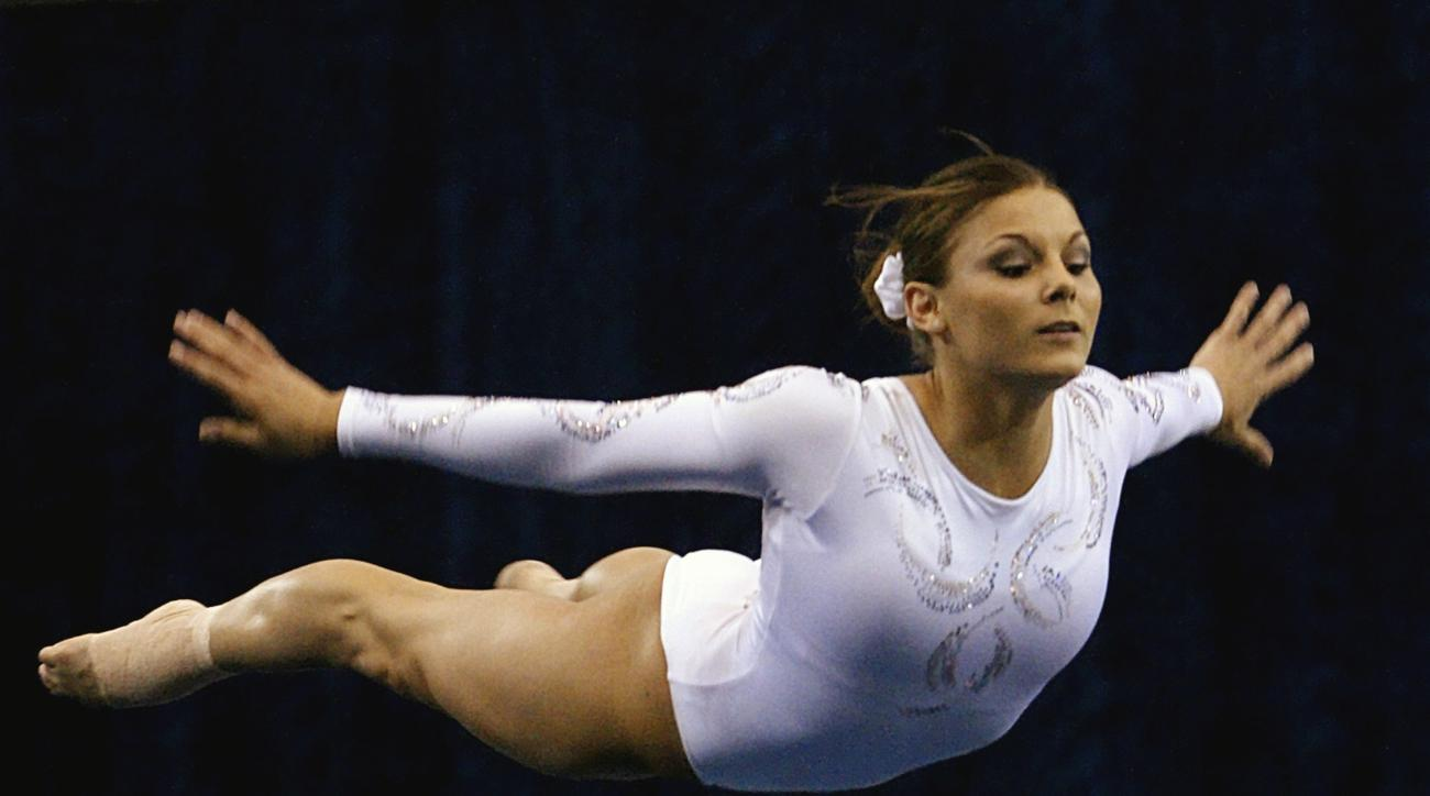 FILE - In this April 15, 2004, file photo, Jamie Dantzscher performs her floor routine during preliminaries at the NCAA women's gymnastics championships in Los Angeles. Dantzscher filed a civil lawsuit in California against USA Gymnastics and a former tea