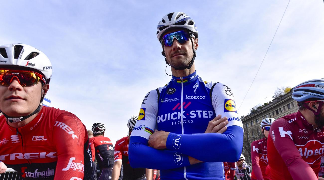 Belgian cyclist Tom Boonen, center, prepares to compete in the 108th edition of the Milano-Sanremo cycling race from Milan to Sanremo,  in Milan, Italy, Saturday, March 18, 2017. (Dario Belingheri/ANSA via AP)