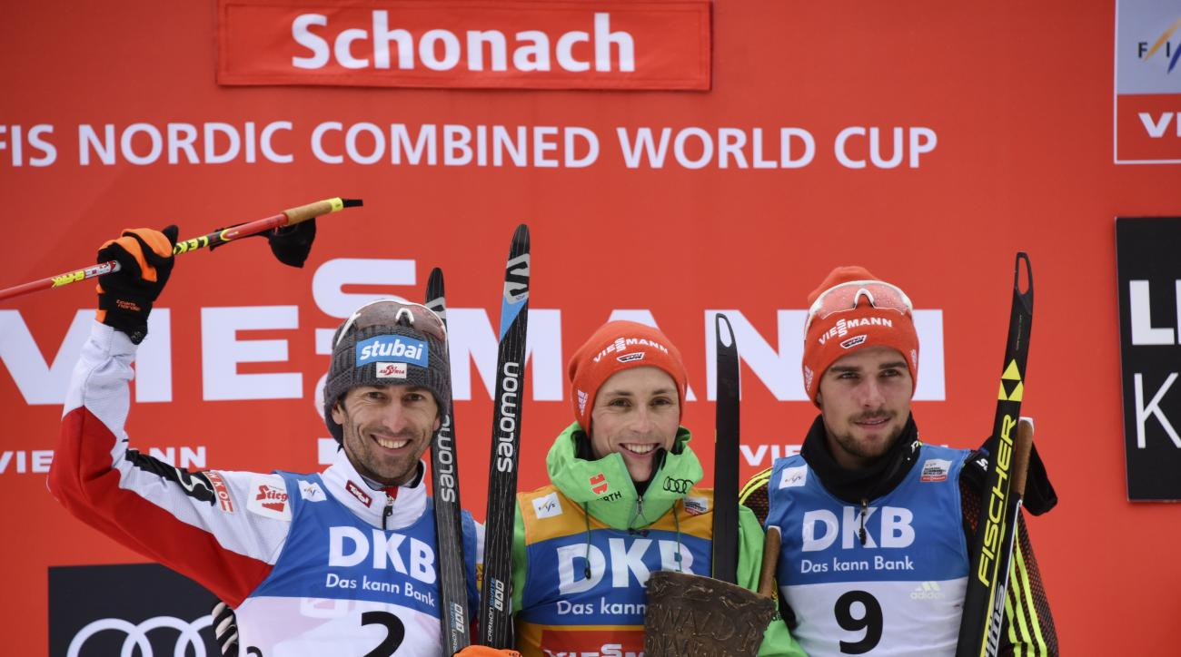 Second placed Austrian Wilhelm Denifl, Germany's winner Eric Frenzel and third placed German Johannes Rydzek, from left, celebrate on the podium after the Nordic Combined World Cup in Schonach, Germany, Saturday, March 18, 2017. (Patrick Seeger/dpa via AP