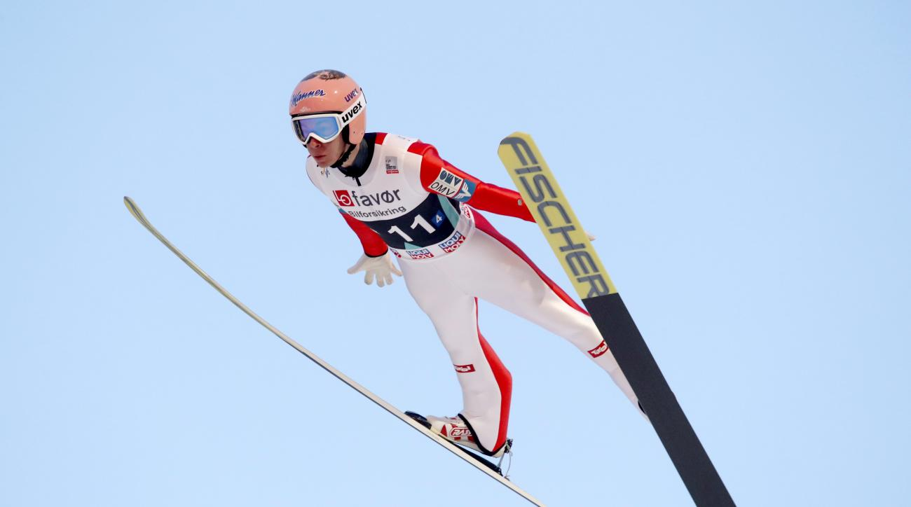 Austria's Stefan Kraft in the air before setting a new world record, during the Men's Team HS225 in Vikersund, Saturday, March 18, 2017. (Terje Bendiksby, NTB scanpix via AP)
