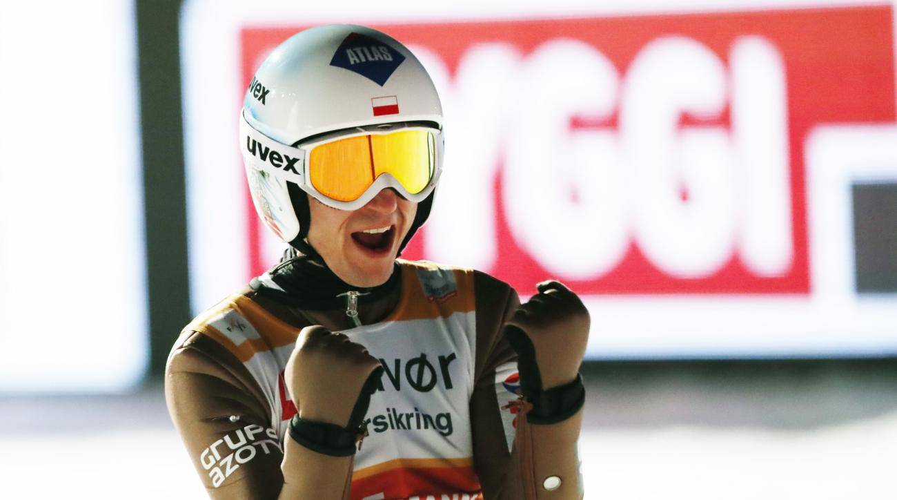 Poland's Kamil Stoch reacts after  a jump of  243 meters in the 2nd run of the FIS Ski Jumping World Cup, Men's Team HS225 in Vikersund, Norway, Saturday, March 18, 2017.  (Terje Bendiksby, NTB scanpix via AP)