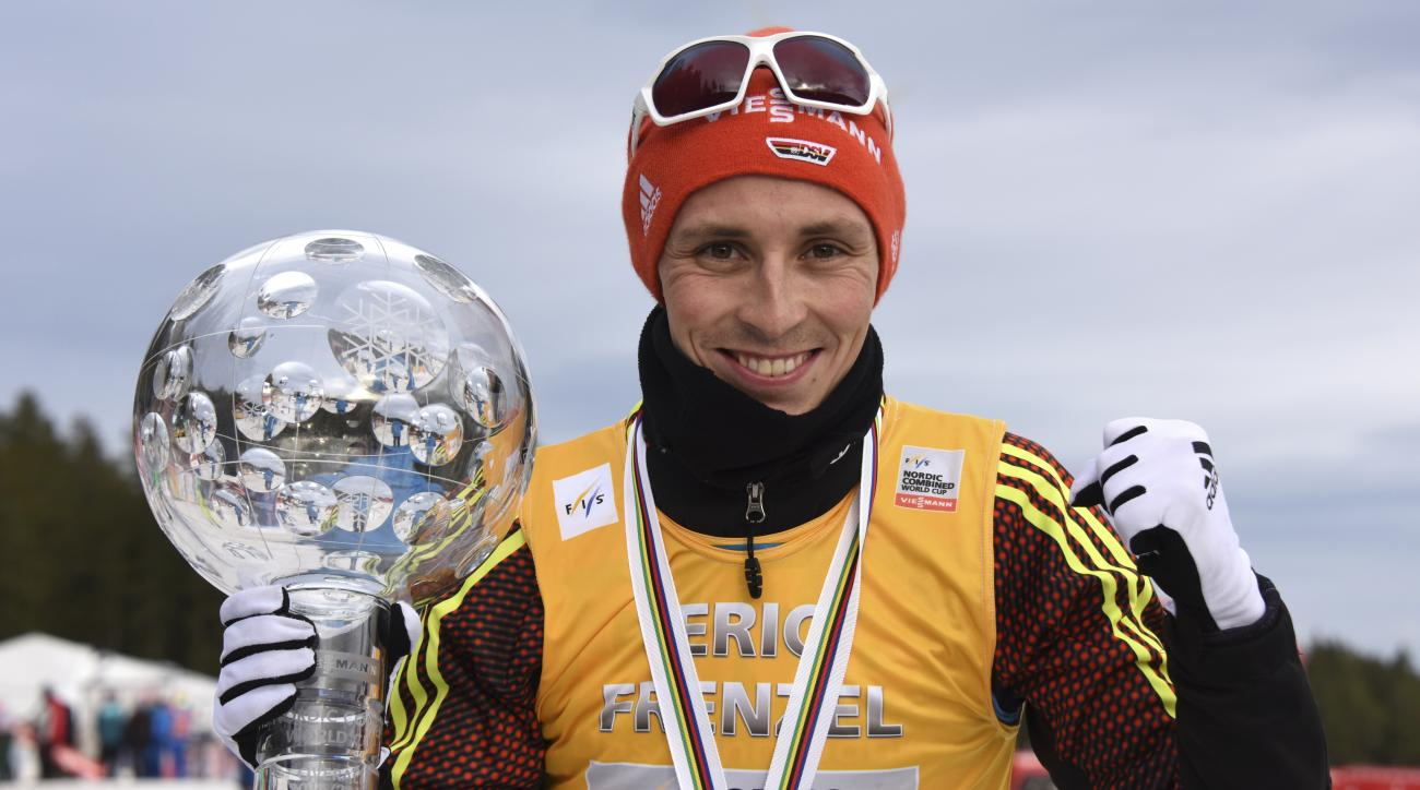 Eric Frenzel of Germany celebrates with the trophy after winning the overall Nordic Combined World Cup in Schonach, Germany, Sunday, March 19, 2017. (Patrick Seeger/dpa via AP)