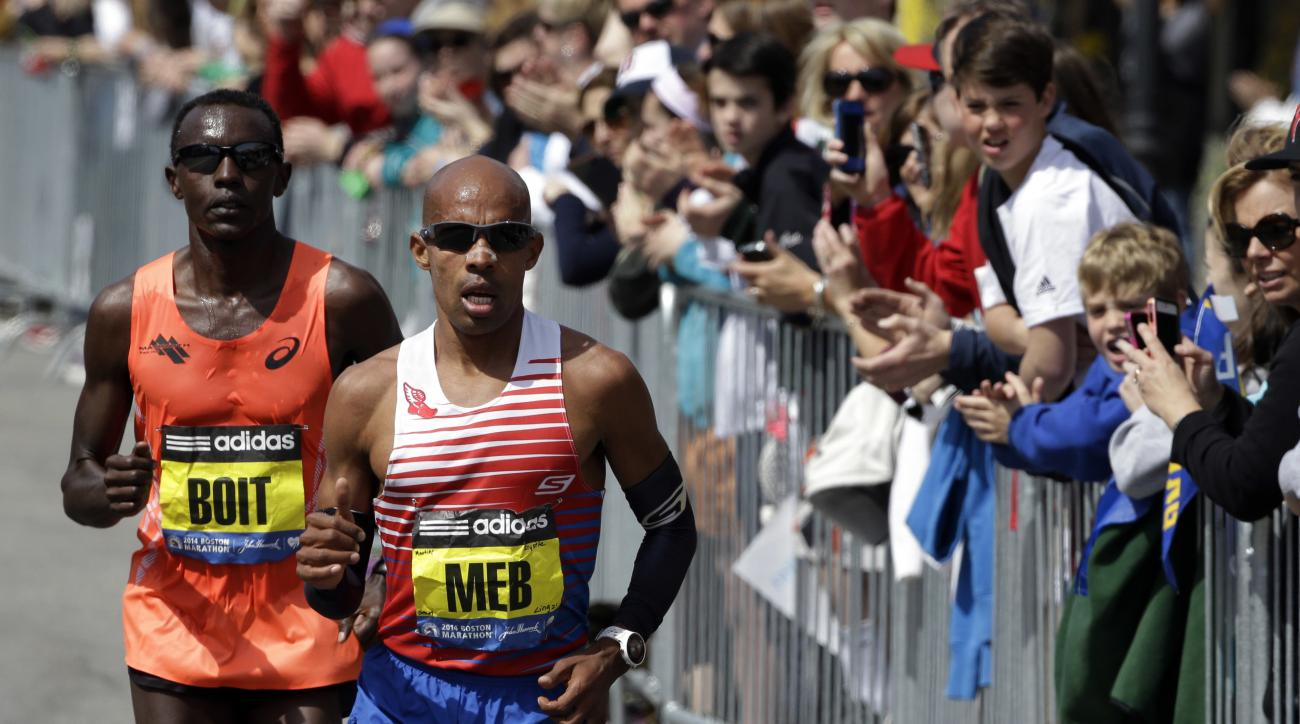 FILE - In this April 21, 2014 file photo, Meb Keflezighi leads Josphat Boit along the course of the 118th Boston Marathon in Boston. Keflezighi said he'll hang up his racing shoes for good after running the April 17, 2017, Boston Marathon and the TCS New