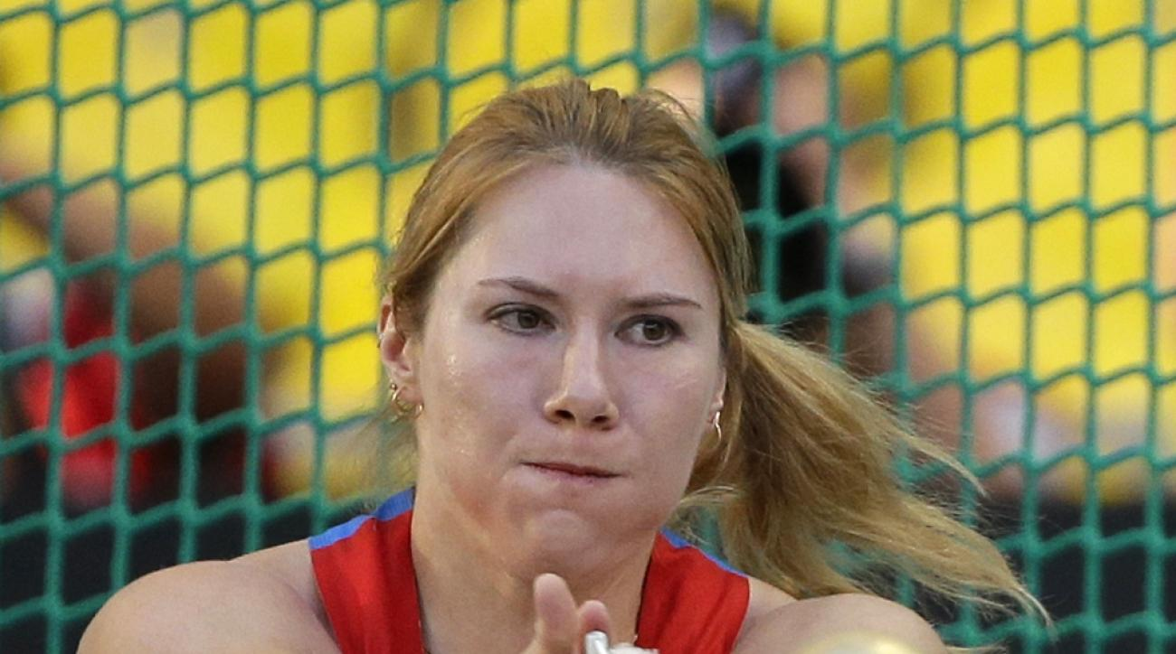FILE In this Friday, Aug. 16, 2013 file photo Russia's Gulfiya Khanafeyeva competes in the the women's hammer throw final at the World Athletics Championships in the Luzhniki stadium in Moscow, Russia. Russian officials say three of the country's athletes