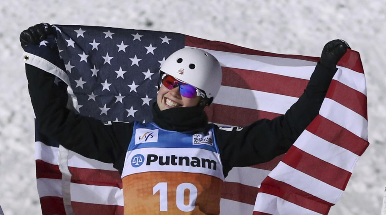 FILE - In this Jan. 14, 2017, file photo, Ashley Caldwell celebrates winning the women's freestyle World Cup aerials competition in Lake Placid, N.Y. Caldwell will make or miss her third U.S. Olympic team, then win or lose the gold medal, by doing triple