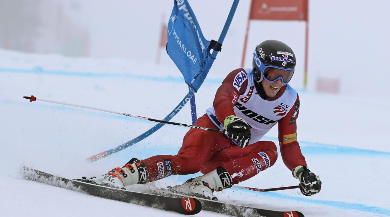 Hig Roberts, of Steamboat Springs, Colo., bends a gate as he heads down the course on his first run at the men's giant slalom skiing race at the U.S. Alpine Ski Championships at Sugarloaf Mountain Resort in Carrabassett Valley, Maine, Tuesday, March 28, 2