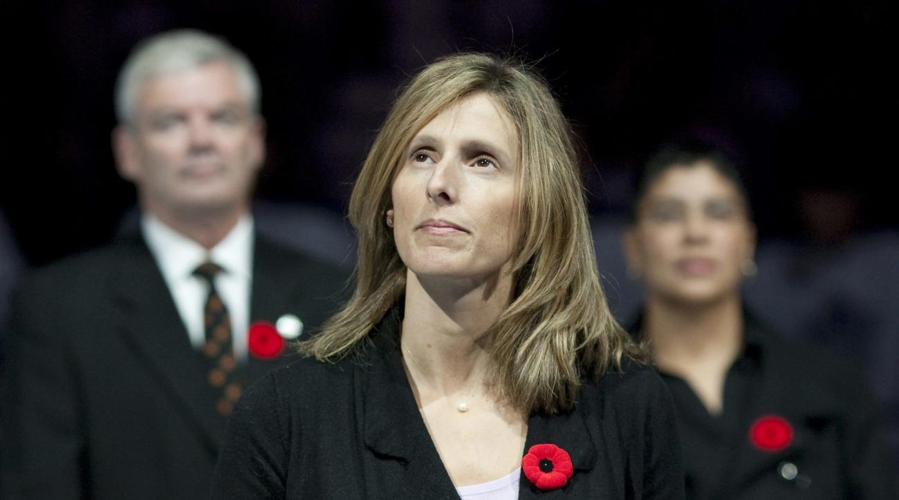 FILE - In this Nov. 6, 2010, file photo, Cammi Granato stands on center ice after being inducted into the Hockey Hall of Fame before an NHL game between the Toronto Maple Leafs and the Buffalo Sabres in Toronto. Granato's biggest victory in hockey came 12