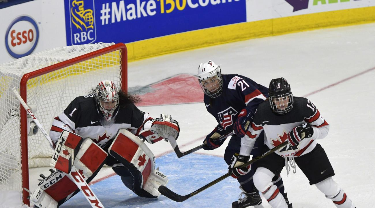 United States goalie Nicole Nensley stops a shot by Canada forward Natalie Spooner (24) during the first period of an IIHF Women's World Championship hockey tournament game, Friday, March 31, 2017, in Plymouth, Mich. (Jason Kryk/The Canadian Press via AP)