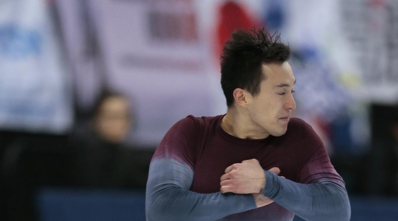 Patrick Chan, of Canada, skates his free program at the World figure skating championships in Helsinki, Finland, on Saturday, April 1, 2017. (AP Photo/Ivan Sekretarev)