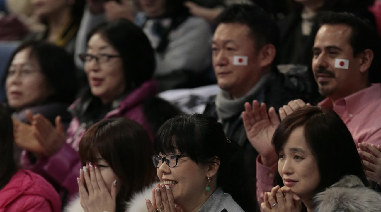 fans watch Hanyu Yuzuru, of Japan, skating his free program to win the gold at the World figure skating championships in Helsinki, Finland, on Saturday, April 1, 2017. (AP Photo/Ivan Sekretarev)