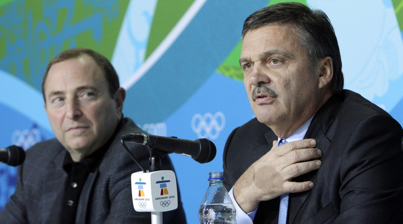FILE - In this Feb. 18, 2010, file photo, Rene Fasel, International Ice Hockey Federation President, right, and Gary Bettman, National Hockey League Commissioner,  are seen during a press conference at the Vancouver 2010 Olympics in Vancouver, British Col