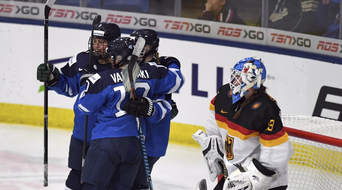 Finland celebrates a goal by Petra Nieminen (11) as Germany goaltender Ivonne Schroder (13) looks on during second-period action in the women's ice hockey world championships in Plymouth, Mich., Friday, April 7, 2017. (Jason Kryk/The Canadian Press via AP