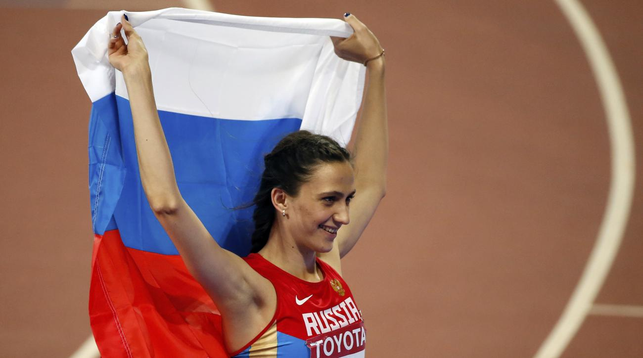 FILE - In this Saturday, Aug. 29, 2015 file photo, Russia's Maria Kuchina celebrates after winning the women's high jump final at the World Athletics Championships at the Bird's Nest stadium in Beijing. Track and fields governing body has approved seven R