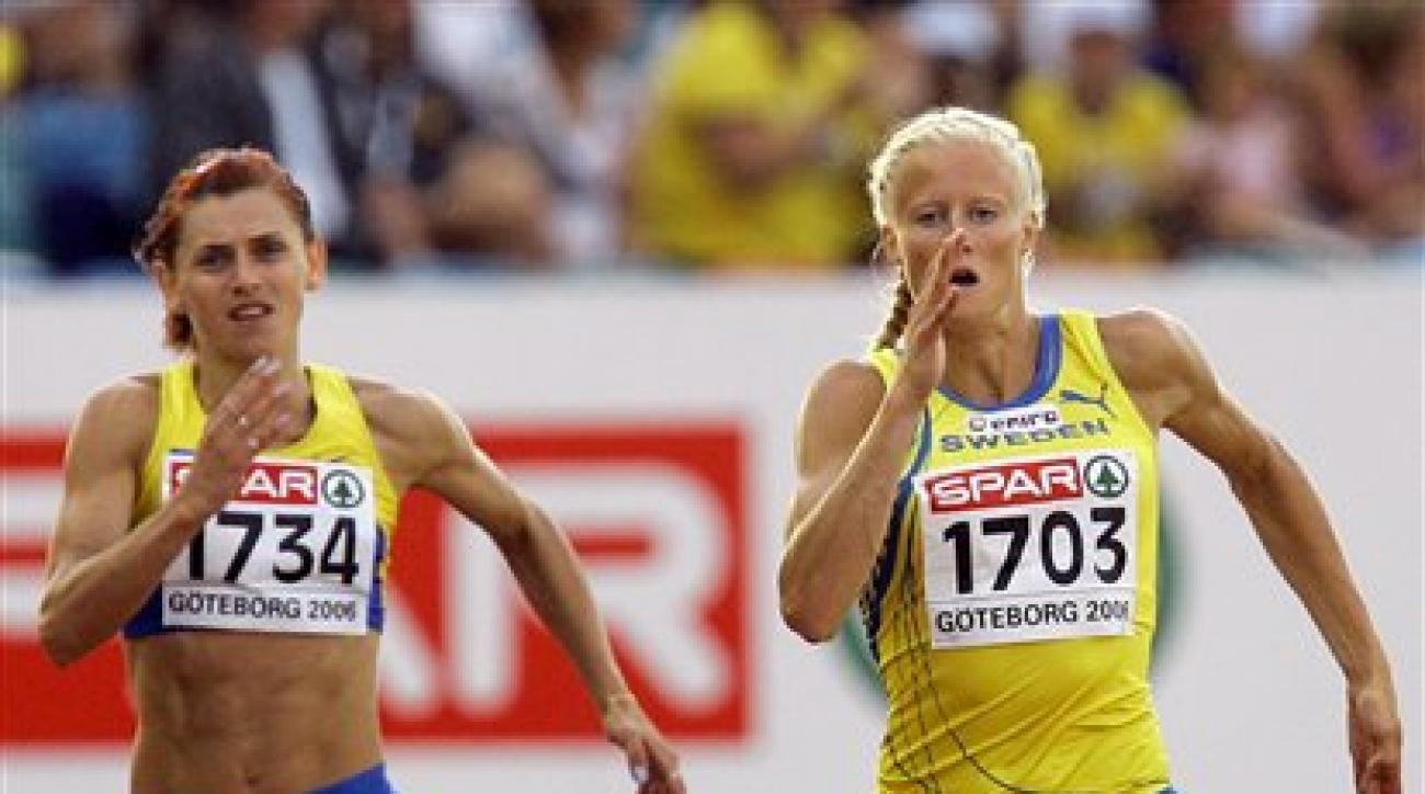 FILE In this Monday Aug. 7, 2006 file photo Lyudmyla Blonska of Ukraine, left, and Sweden's Carolina Kluft compete in the Heptathlon 200 meters at the European Athletics Championships in Goteborg, Sweden. A plan to offer amnesty to Ukrainian track and fie