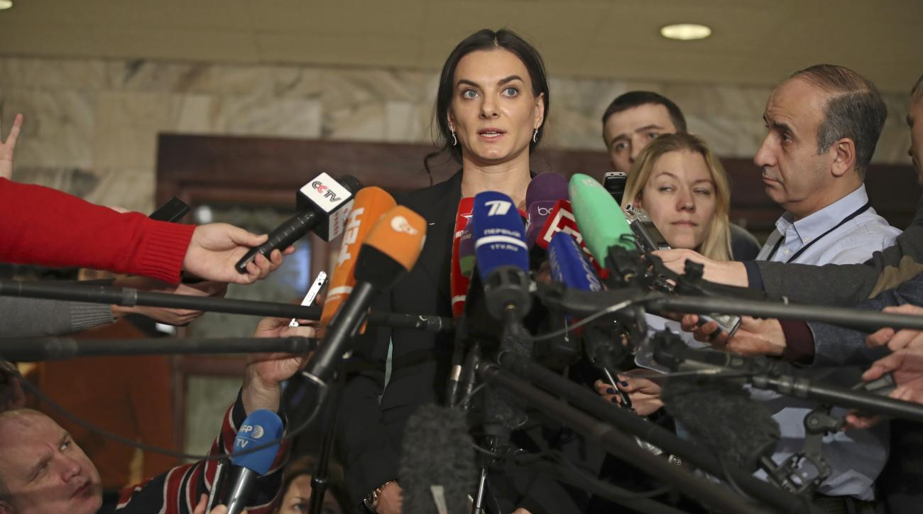 """FILE - In this Friday, Dec. 9, 2016 file photo, former Russian pole vaulter Yelena Isinbayeva speaks to the media in Moscow, Russia. The IAAF says Russia is making """"little progress"""" cleaning up its doping culture to secure its reinstatement into athletics"""