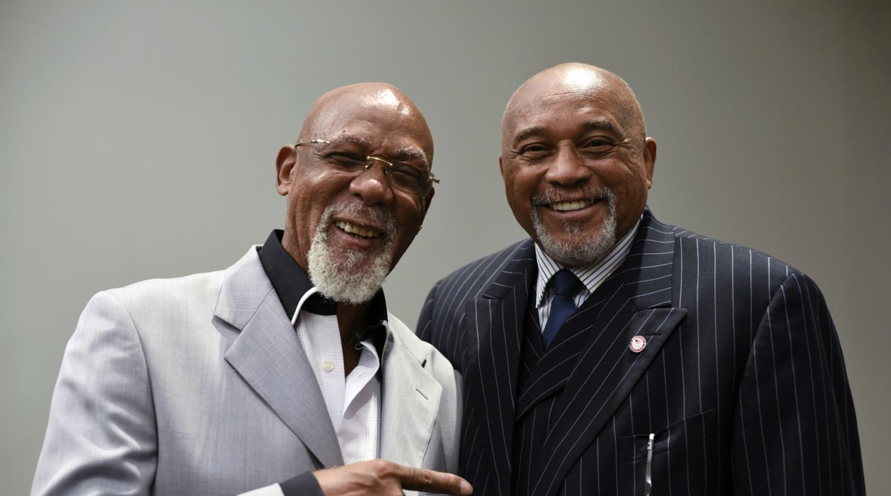 FILE - In this Sept. 28, 2016, file photo, U.S. Olympians John Carlos, left, and Tommie Smith, who famously raised black-gloved fists during a 1968 medal ceremony, pose for a portrait at Georgetown University in Washington. Tommie Smith says hes proud to