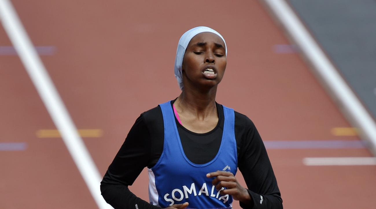 FILE - This is a Friday, Aug. 3, 2012 file photo of Somalia's Zamzam  Farah as she crosses the finish line of a women's 400-meter heat during the athletics in the Olympic Stadium at the 2012 Summer Olympics, London. Farah  who sought asylum in London afte