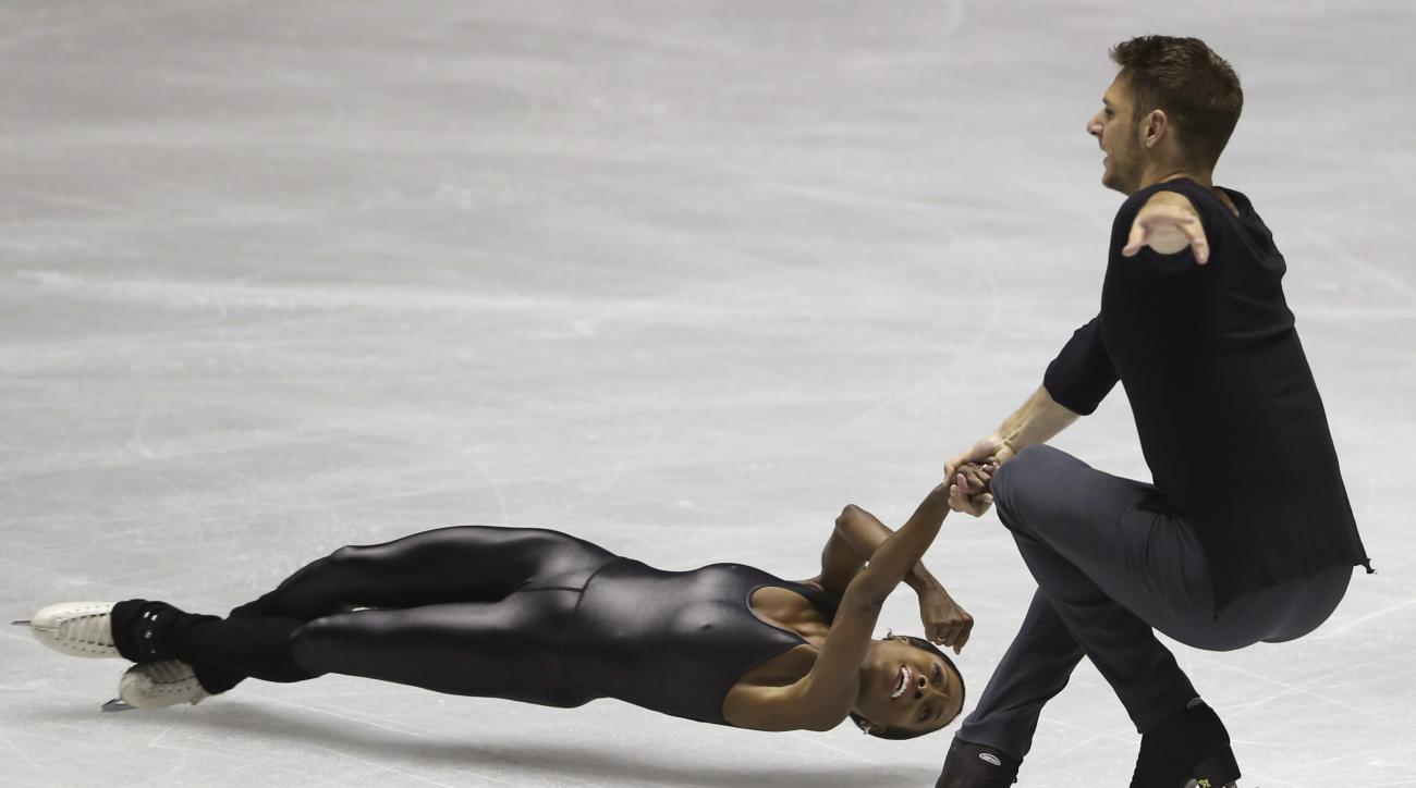 French pair Vanessa James and Morgan Cipres perform during their pairs free skating of World Team Trophy Figure Skating in Tokyo, Saturday, April 22, 2017. (AP Photo/Koji Sasahara)