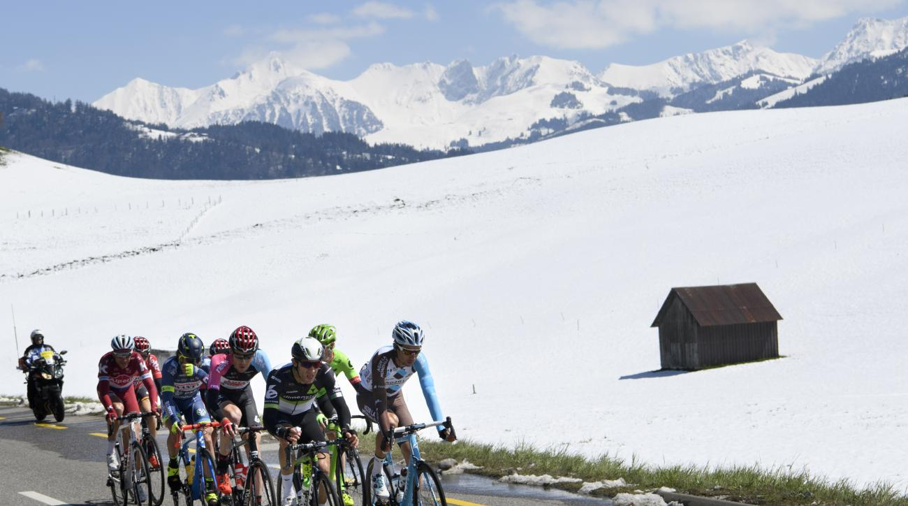 Cyclists climb the Jaunpass during the fourth stage, a 163.5 km race between Domdidier and Leysin at the 71th Tour de Romandie UCI ProTour cycling race in Planfayon, Switzerland, Saturday, April 29, 2017. (Jean-Christophe Bott/Keystone via AP)